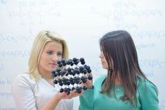 Happy teens group in school Stock Photo