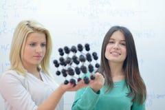 Happy teens group in school Stock Images