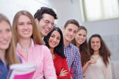 Happy teens group in school Royalty Free Stock Photography