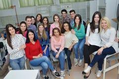 Happy teens group in school Royalty Free Stock Image