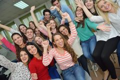 Happy teens group in school Stock Image