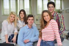 Happy teens group in school Royalty Free Stock Photos