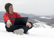 Happy teens with laptop in winter mountains. Happy teens student with laptop in hand in winter mountains Tien Shan Royalty Free Stock Images