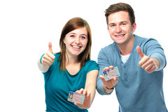 Happy teens showing their driving license Stock Photos