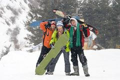 Happy teens snowboarding teams royalty free stock photography