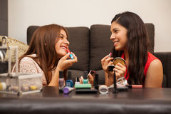 Happy teens wearing makeup Stock Photos