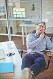 Happy telephone conversation Stock Image