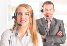 Happy Telephone Operators in call center Royalty Free Stock Photo