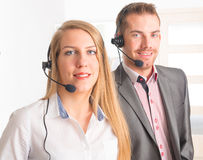 Happy Telephone Operators in call center Stock Images