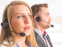 Happy Telephone Operators in call center Stock Photo