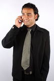 Happy Telephonic Conversation. A handsome Indian businessman with a happy expression, while talking on his cellphone Stock Photos