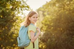 Ten-year-old girl with a backpack on your back outdoors royalty free stock photo