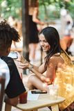 Happy tennage couple spending time at the cafe. Drinking juice royalty free stock photography