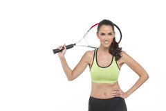 Happy tennis player. A happy woman holding a tennis racket. Photographed in studio Royalty Free Stock Images