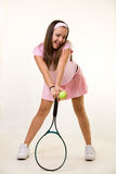 Happy tennis player in pink Royalty Free Stock Images
