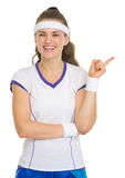 Happy tennis player pointing on copy space Stock Photography