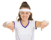 Happy tennis player pointing down Royalty Free Stock Photography
