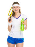 Happy tennis player with racket and water bottle Royalty Free Stock Photo