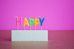 Happy text candle colorful on foam. Royalty Free Stock Image