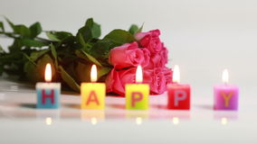 Happy text candle flame stock video footage