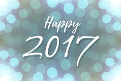 Happy 2017 text design. On lights bokeh background or banner. Vector festive shiny illustration Stock Image
