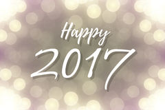 Happy 2017 text design. On lights bokeh background or banner. Vector festive shiny illustration Royalty Free Stock Photography