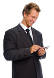 Happy texting man Stock Images
