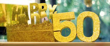 Happy 50th Birthday glittering props on a table. Alligned horitontally with beautiful bookeh royalty free stock image