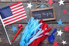 Happy 4th of July. American flag and frame with inscription Happy 4th of July on wooden table stock images