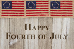 Happy 4th of July Greeting. Happy Independence Day Greeting, USA patriotic old flag on a weathered wood background with text Happy 4th of July Day stock photography