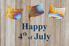 Happy 4th of July greeting. Happy 4th of July text with USA patriotic old metal flags on a weathered wood stock images