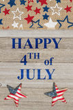 Happy 4th of July greeting. Happy 4th of July text with USA red, white and blue stars burlap ribbon on weathered wood stock images