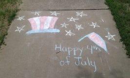 Happy 4th Of July Message. Sidewalk chalk drawing of 4th of July message stock image