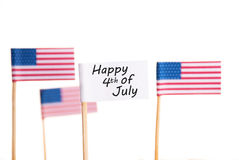 Happy 4th of July. A White Flag with Happy 4th of July and some American Flags in the Background, Isolated stock image