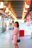 Happy Thai woman at Japanese shopping mall Stock Photo