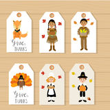 Happy Thanks giving tags with pilgrim  and red indian costume ch. Ildren vector. illustration EPS10 Stock Images