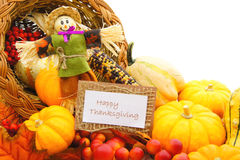 Happy Thanksgiving. Card and scarecrow among a cornucopia of autumn vegetables Royalty Free Stock Image