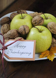 Happy Thanksgiving Autumn Fall harvest closeup. Happy Thanksgiving Autumn Fall harvest fruits with green apples and walnut nuts in white heart shape plate on royalty free stock photography