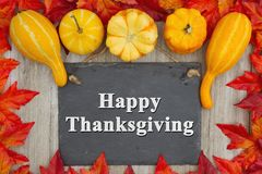 Happy Thanksgiving with autumn leaves with a retro chalkboard wi royalty free stock photo