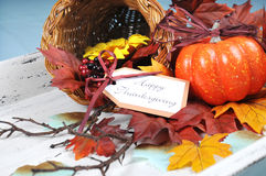Happy Thanksgiving cornucopia with Autumn Fall leaves close up. Happy Thanksgiving cornucopia with Autumn Fall leaves, pumpkin, sunflower and berries on white Royalty Free Stock Images