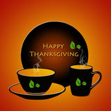 Happy Thanksgiving. With cup, saucer and a plate on orange background Royalty Free Stock Photography