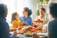 Happy Thanksgiving Day. ! Autumn feast. Family sitting at the table and celebrating holiday. Grandparents, mother, father and child. Traditional dinner royalty free stock photos