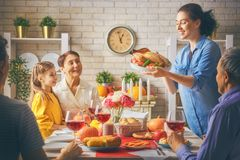 Happy Thanksgiving Day. ! Autumn feast. Family sitting at the table and celebrating holiday. Grandparents, mother, father and child. Traditional dinner Stock Photo