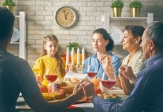 Happy Thanksgiving Day. ! Autumn feast. Family sitting at the table and celebrating holiday. Grandparents, mother, father and child. Traditional dinner stock photography
