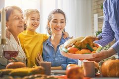 Happy Thanksgiving Day. ! Autumn feast. Family sitting at the table and celebrating holiday. Grandparents, parents and children. Traditional dinner Stock Photo