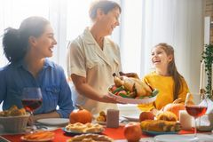 Happy Thanksgiving Day. ! Autumn feast. Family sitting at the table and celebrating holiday. Traditional dinner. Grandmother, mother and daughter stock image