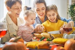 Happy Thanksgiving Day. ! Autumn feast. Family sitting at the table and celebrating holiday. Traditional dinner. Grandmother, mother and daughter Stock Photo