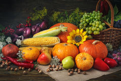 Happy Thanksgiving Day background, wooden table decorated with Pumpkins, Maize, fruits and autumn leaves. Beautiful autumn festival the festival scene is Stock Photo