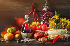 Happy Thanksgiving Day background, wooden table, decorated with vegetables, fruits and autumn leaves. Autumn background. Royalty Free Stock Image