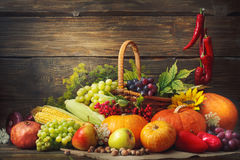 Happy Thanksgiving Day background, wooden table, decorated with vegetables, fruits and autumn leaves. Autumn background. Happy Thanksgiving Day background royalty free stock photography